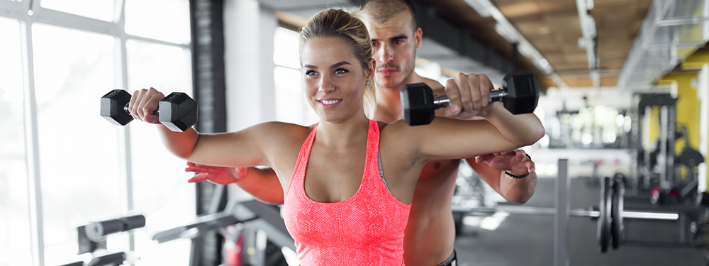 Woman exercising in gym. Hemp oil and exercise supports stress management.