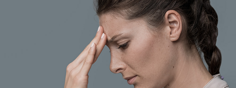 woman with headache from anxiety. buy hemp oil online usa. cbd oil and other social anxiety natural supplements.