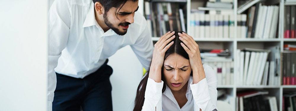Stress at work with angry boss yelling at female worker under stress and anxiety. Buy CBD oil online USA. CBD oil for anxiety and depression.