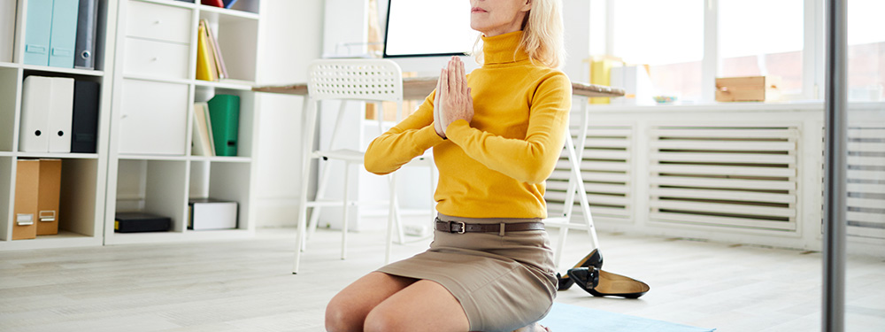 elderly woman in yoga pose CBD helps with anxiety.