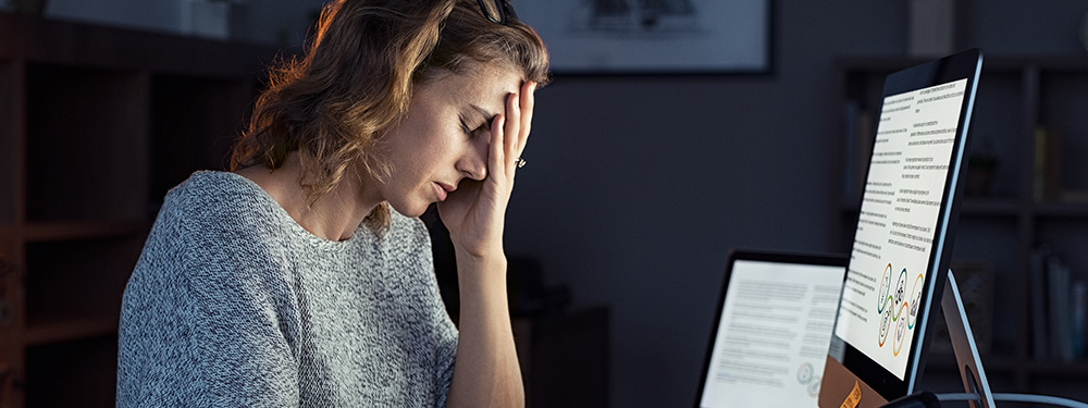 Adult woman with anxiety at work. How does CBD oil help manage stress and depression? CBD oil for anxiety by online USA.