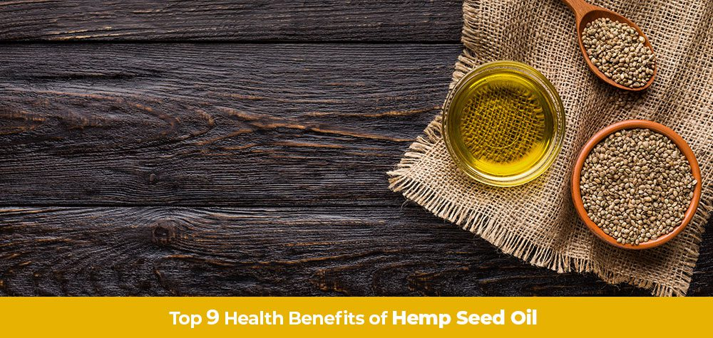 Hemp seed oil in a jar next to hemp seed. Benefits of hemp seed oil for health and wellness. Buy hemp oil online USA.