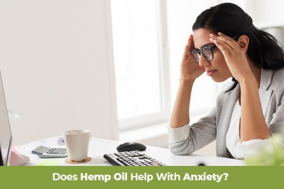 Anxious woman working at a computer holding her head. Does hemp oil help with anxiety? Buy all natural anxiety supplements online with hemp cbd.